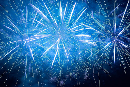 14655142 - blue colorful holiday fireworks on the black sky background.